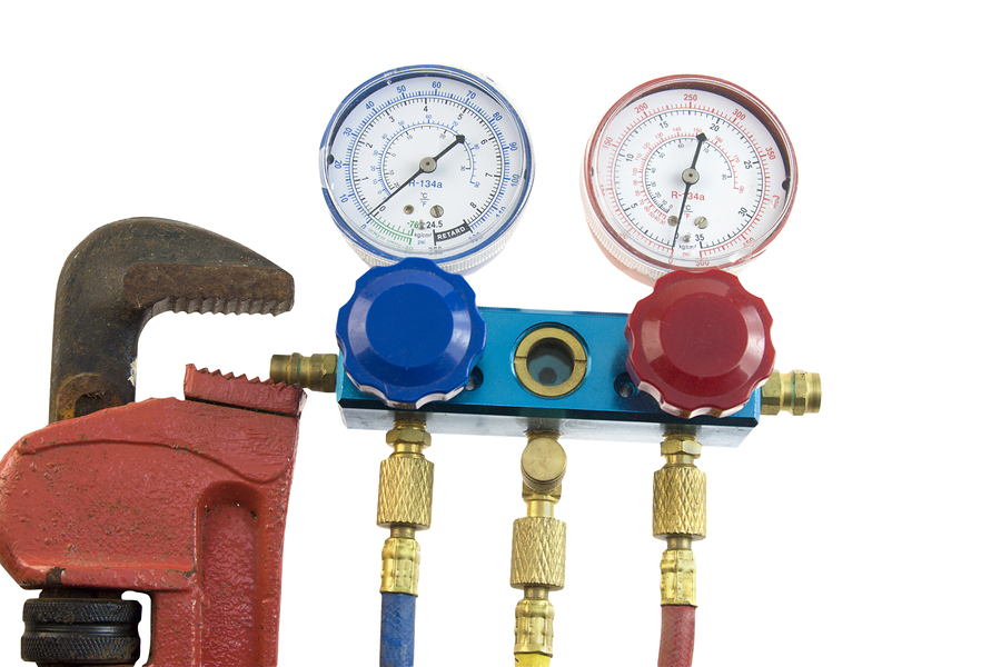 air conditioning manifold with high and low pressure gauges and valves commonly used in HVAC maintenance